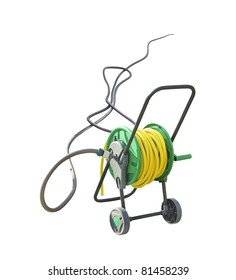 Hosepipe Holder on wheels. Hose reel trolley isolated on white background. Yellow coil hose with watering pipe. Modern garden hose on the spool.