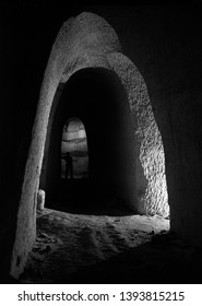 "Hosin, Czech republic - July 25 2011: A corridor in abandoned kaolin mine named ""Orty"". Focused on crossing of two adits under an arch, with a blurred human silhouette in the distance. Shot on film."