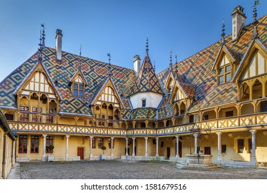 Hospices de Beaune or Hotel-Dieu de Beaune is a former charitable almshouse in Beaune, France. Courtyard, internal facade with polychrome roof