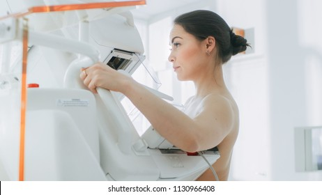 In the Hospital, Back View Shot of Topless Female Patient Undergoing Mammogram Screening Procedure. Healthy Young Female Does Cancer Preventive Mammography Scan. Modern Hospital with High Tech Machine