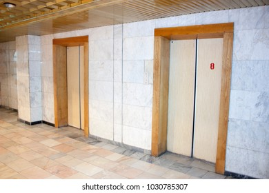Hospital bed and lift and corridor