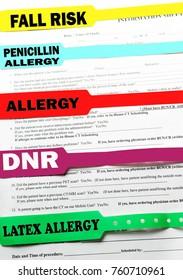 Hospital bracelets on top of hospital paperwork forms