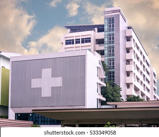 hospital building with big symbolic at cloudy day