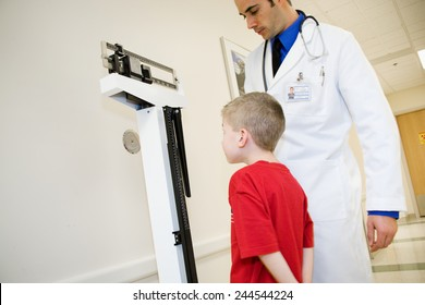 Hospital: Doctor Weighs Boy On Traditional Scale