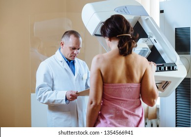 In the Hospital, Female Patient Listens to Mammography Technologist / Doctor Uses Tablet Computer, Explains Importance of Breast Cancer Prevention. Mammography Procedure.