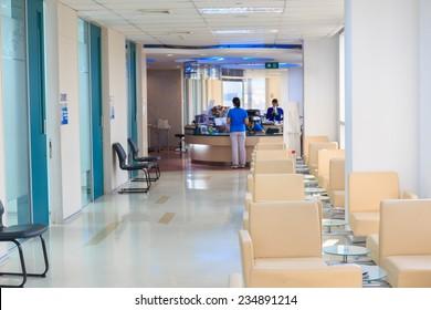 hospital indoor hallway and waiting seats.