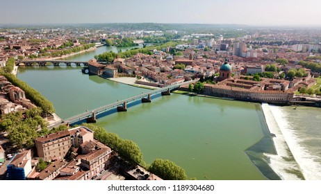 Hospital la Grave and dome historical in Toulouse France. Saint Pierre Bridge and New Bridge above the Garonne.