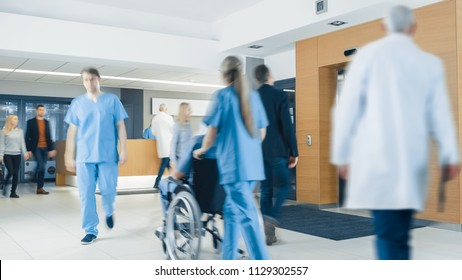Hospital Lobby. Doctors, Nurses, Assistant Personnel and Patients Working and Walking in the Lobby of the Medical Facility.