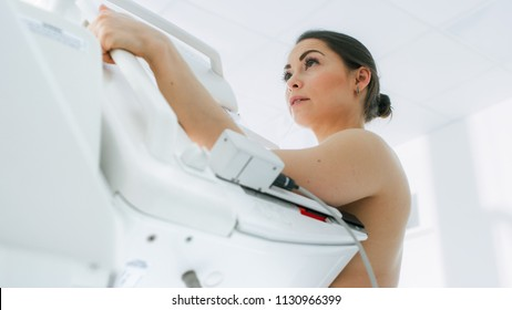 In the Hospital, Low Angle Portrait Shot of Topless Female Patient Undergoing Mammogram Screening Procedure. Healthy Young Female Does Cancer Preventive Mammography Scan. Modern Hospital.