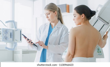 In the Hospital, Mammography Technologist / Doctor adjusts Mammogram Machine for a Female Patient. Friendly Doctor Explains Importance of Breast Cancer Prevention Screening. Modern Clinic.