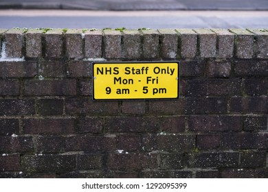 Hospital NHS staff parking only car spaces at work