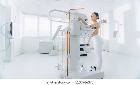 In the Hospital, Portrait Shot of Topless Female Patient Undergoing Mammogram Screening Procedure. Healthy Young Female Does Cancer Preventive Mammography Scan. Modern Hospital with High Tech Machines
