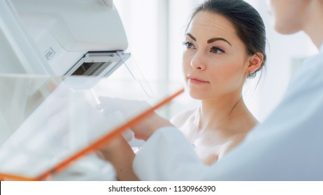 In the Hospital, Portrait Shot of Topless Female Patient Undergoing Mammogram Screening Procedure. Healthy Young Female Does Cancer Preventive Mammography Scan.