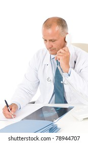 Hospital professional doctor male with stethoscope on phone hold x-ray