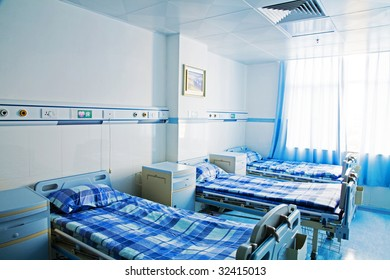 Hospital room with window and beds
