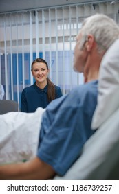 In the Hospital Ward Recovering Father is Visited by Daughter. Senior Sick Man Lying in Bed Talks with Grown up Daughter. Modern Private Ward.