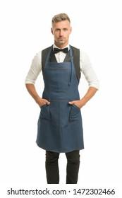 Hospitality staff. Barista handsome worker. Man cook wear apron. Mature barista. Restaurant staff. Hipster professional barista apron uniform. Waiter or bartender. Cafe bar barista job position.