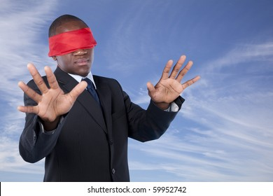 Hostage african businessman with a red blindfold covering his eyes