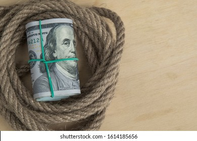 Hostage buyout concept image. Money dollars and rope close up