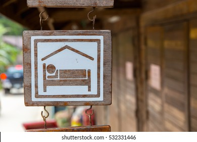 Hostel sign board on wooden in thailand.