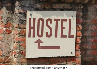 Hostel sign on brick wall background