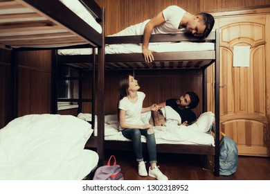 Hostel for Young People. Best Friends Traveling. Small Room in Hostel. spend time Together. bunk beds in room. Friends Sleeping. overnight in Hostel. got up first. sitting with boys