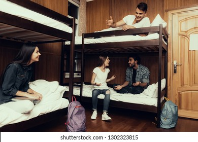 Hostel for Young People. Best Friends Traveling. Small Room in Hostel. spend time Together. bunk beds in room. Friends Sleeping. overnight in Hostel. got up first. sitting with boys. communicate