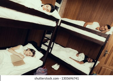 Hostel for Young People. Best Friends Traveling. Small Room in Hostel. spend time Together. bunk beds in room. Girl Sleeping. friends overnight in Hostel. fell asleep with book. sleep in comfort
