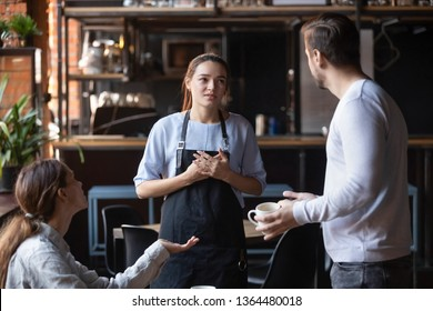 Hostile angry restaurant client couple or friends talking with waiting staff in public place complains about cold coffee long service, spoiled tasteless dish waitress feels guilty mixed orders concept