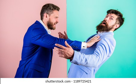 Hostile situation between opposing colleagues. Business partners competitors office colleagues tense faces conflict situation. Business competition and confrontation. Domination and subordination.