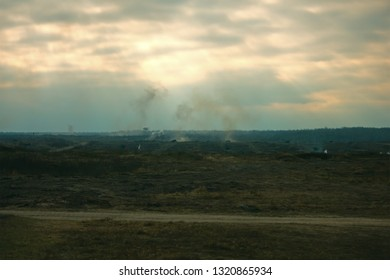 Hostilities. War concept. Military training ground with explosions. Military machines