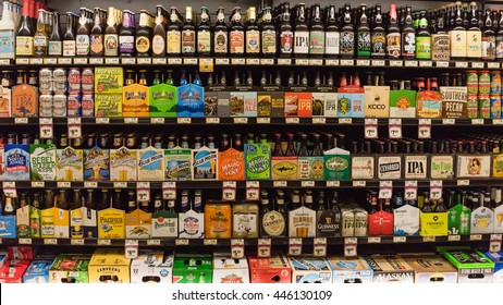 HOSTON,US-JUN 25,2016:Various bottles of craft, microbrews, IPAs, domestic and imported beer beers from around the world on shelf display in supermarket.Alcohol drinks background, different beer style