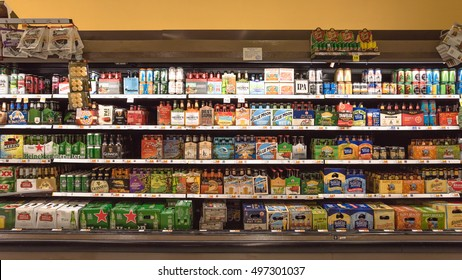 HOSTON,US-OCT 1,2016: Various bottles of craft, microbrews, IPAs, domestic and imported beers from around the world on shelf display in Kroger store. Alcohol drink different beer style. Panorama style