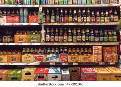 HOSTON,US-OCT 1,2016: Various bottles of craft, microbrews, IPAs, domestic and imported beers from around the world on shelf display in Kroger store. Alcohol drinks background, different beer style.