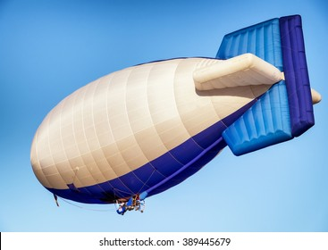 hot air airship - blimp in front of blue sky