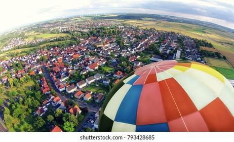 Hot air ballon above a town