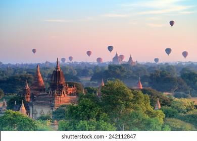 Hot air ballons over pagodas in sunrise at Bagan, Myanmar.