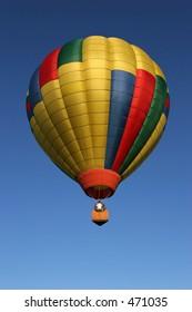 hot air balloon against deep blue sky