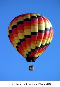 Hot air balloon being fired, increasing in altitude