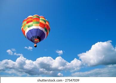 Hot air balloon in the blue sky, wanderlust