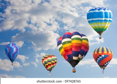 Hot air balloon in blue sky background.