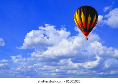 Hot air balloon with blue sky and nice cloud in Thailand.