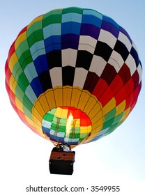 Hot air balloon in flight against a light blue sky