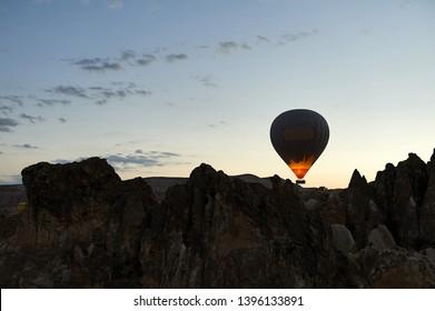 Hot Air Balloon Flight Cappadocia Tour Goreme Open Air Museum, Flying hot air balloons rise in sunrise Cappadocia. Goreme National Park Turkey.