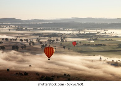 Hot Air Balloon flight over Gold Coast Hinterland, Queensland, Australia at sunrise in mid winter