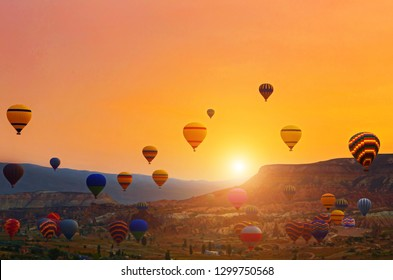 Hot Air Balloon Flight South Cappadocia Tour Goreme Open Air Museum, Flying hot air balloons rise in sunrise Cappadocia. Goreme National Park Turkey.