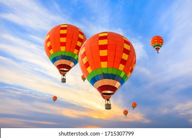 Hot air balloon floating in the sky at sunset.