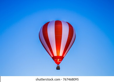 Hot air balloon is floating in the sky.