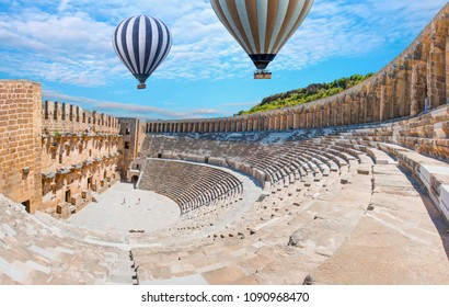 Hot air balloon flying over Aspendos amphitheater - Antalya Turkey