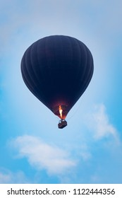 hot air balloon flying over blue sky